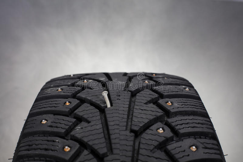 Close Up Photo Of Winter Tire With A Nail In Finland. Stock Photo ...