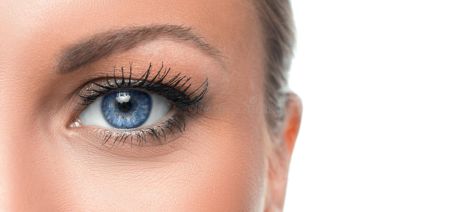 Close up photo of a woman`s blue eye royalty free stock photo
