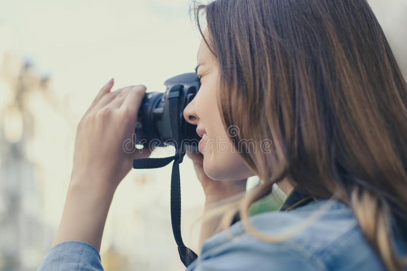 Close up photo of woman taking picture on her digicam for having happy memories of an old city, beauty fashion lifestyle leisure f royalty free stock photo