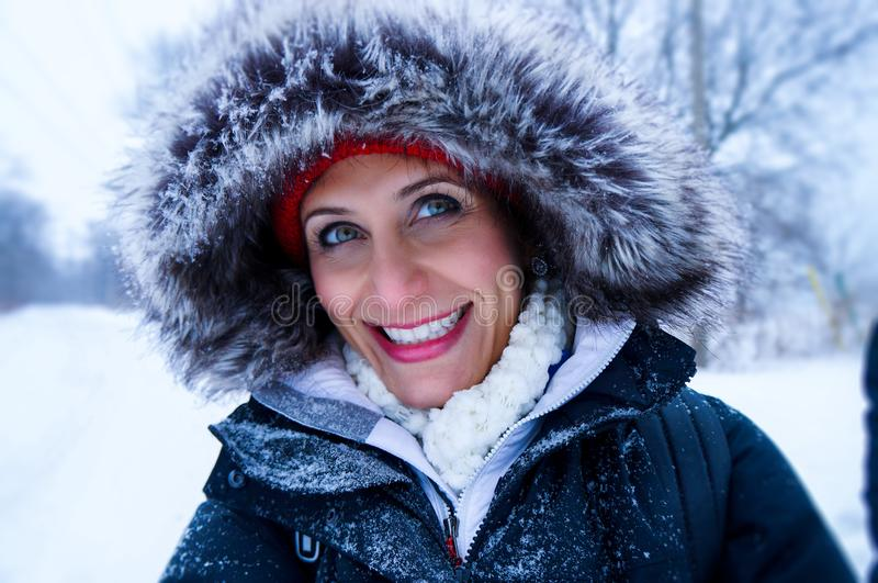 Close Up Photo of Woman Wearing Black Zip-up Parka Coat during Snow Season royalty free stock image