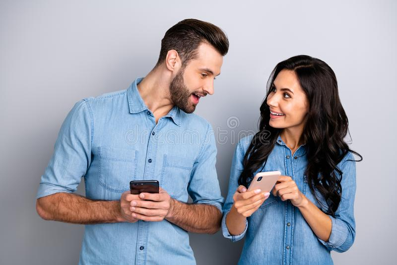 Close up photo wondered she her he him his lady guy telephone smart phone hands arms read reader news look interest eyes. Wear casual jeans denim shirts outfit royalty free stock images