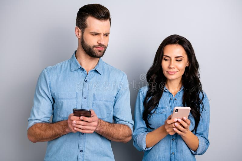 Close up photo wondered she her he him his lady guy telephone smart phone hands arms reader doubt unsure uncertain. Loyalty wear casual jeans denim shirts royalty free stock photography