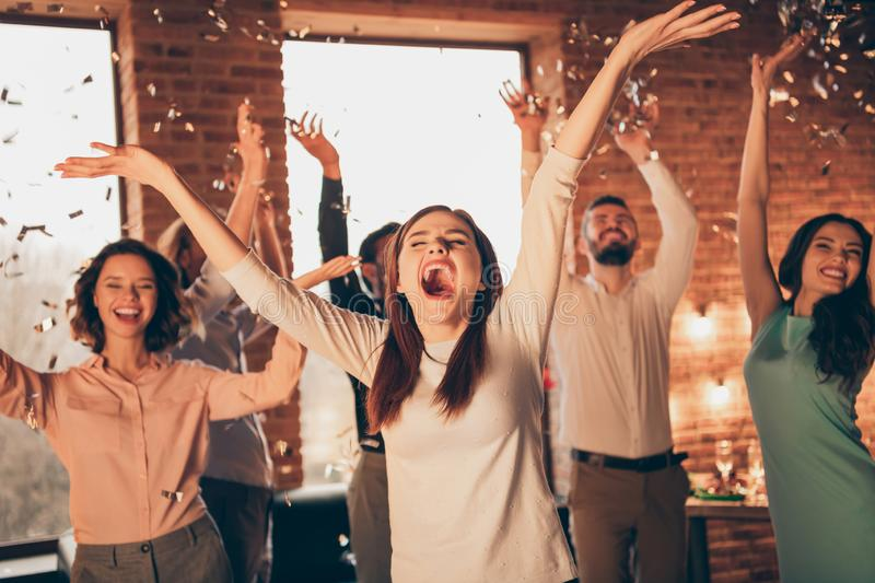 Close up photo yelling loud friends event hang out dancing drunk birthday sing singer hands arms raised up she her. Ladies he him his guys wear dress shirts royalty free stock images