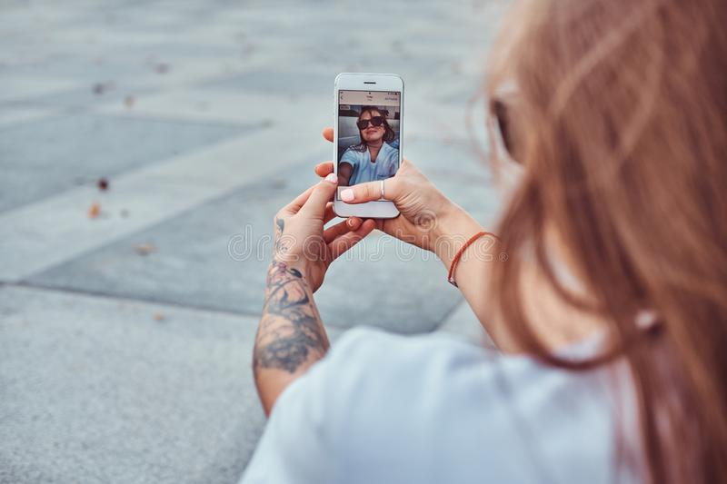 Close-up photo of young girl in sunglasses makes a selfie outdoors. Close-up photo of a young girl in sunglasses makes a selfie outdoors stock image