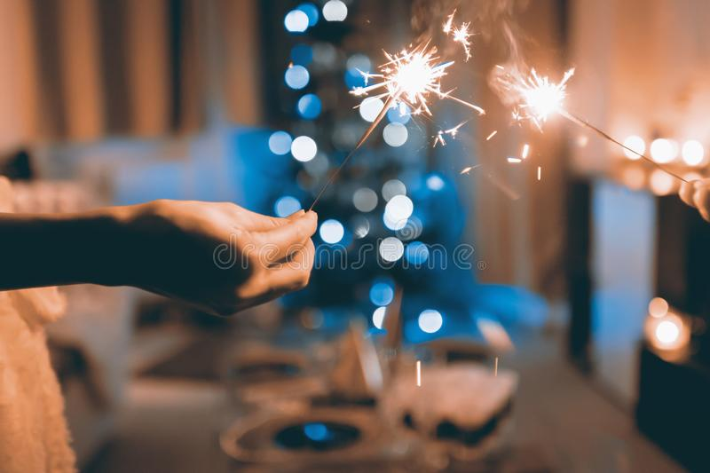 Close Up Photograph Of Two Person Holding Sparklers Free Public Domain Cc0 Image