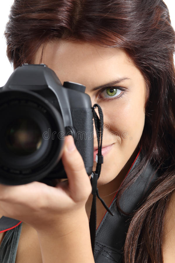 Close up of a photographer woman holding a digital slr camera. Isolated on white stock photos