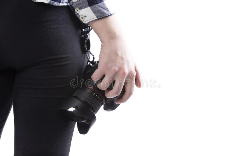 Close up of Photographers Camera and Lens stock photo