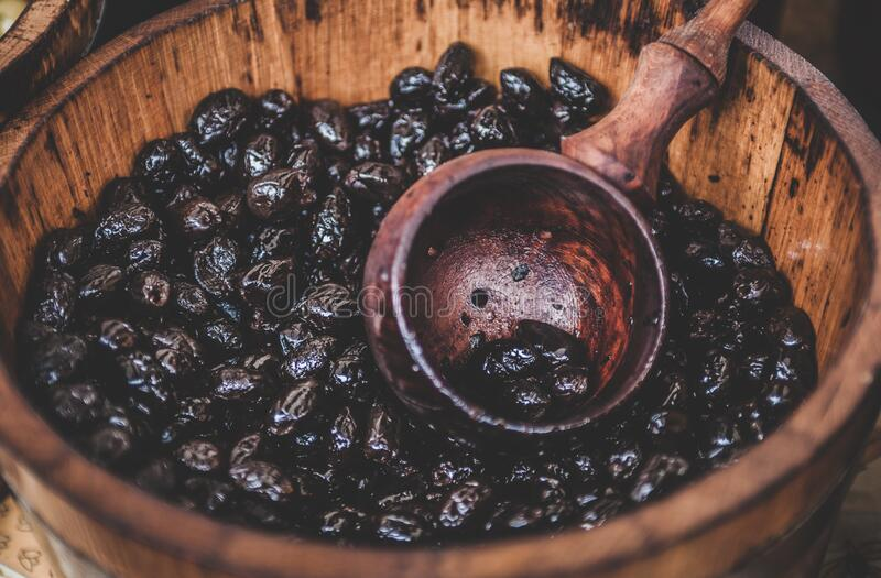 Close up Photography of Black Berry in Brown Wooden Container stock images