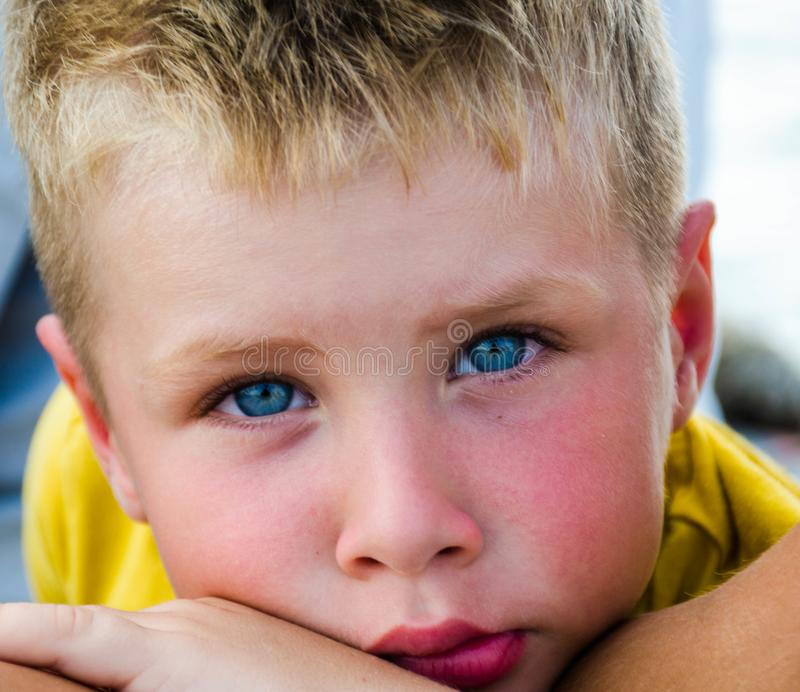 Close-Up Photography of Boy With Blue Eyes royalty free stock photos