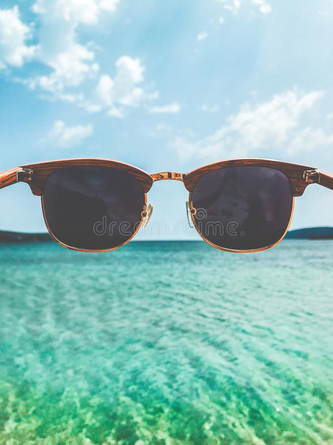 Close Up Photography of Brown Clubmaster Style Sunglasses stock image