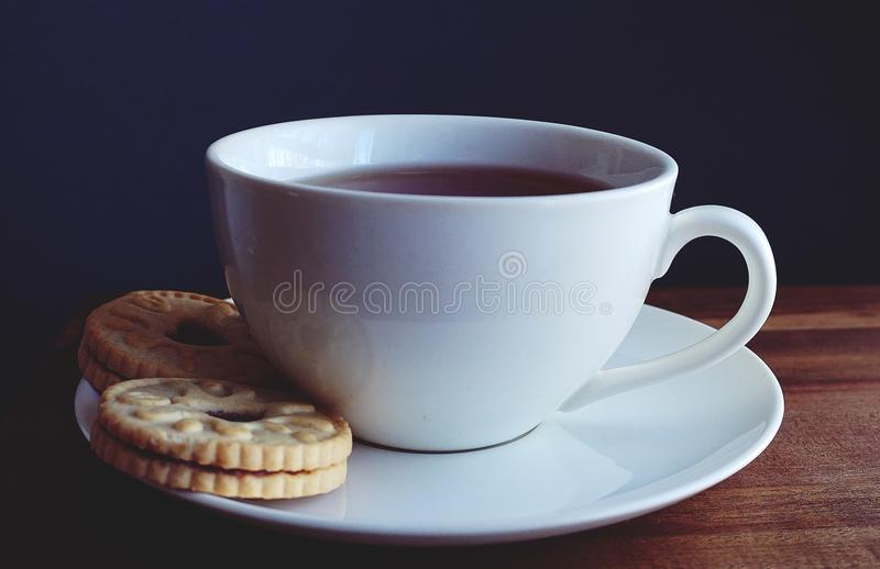 Close-up Photography of Cup of Coffee Near Biscuits stock photography