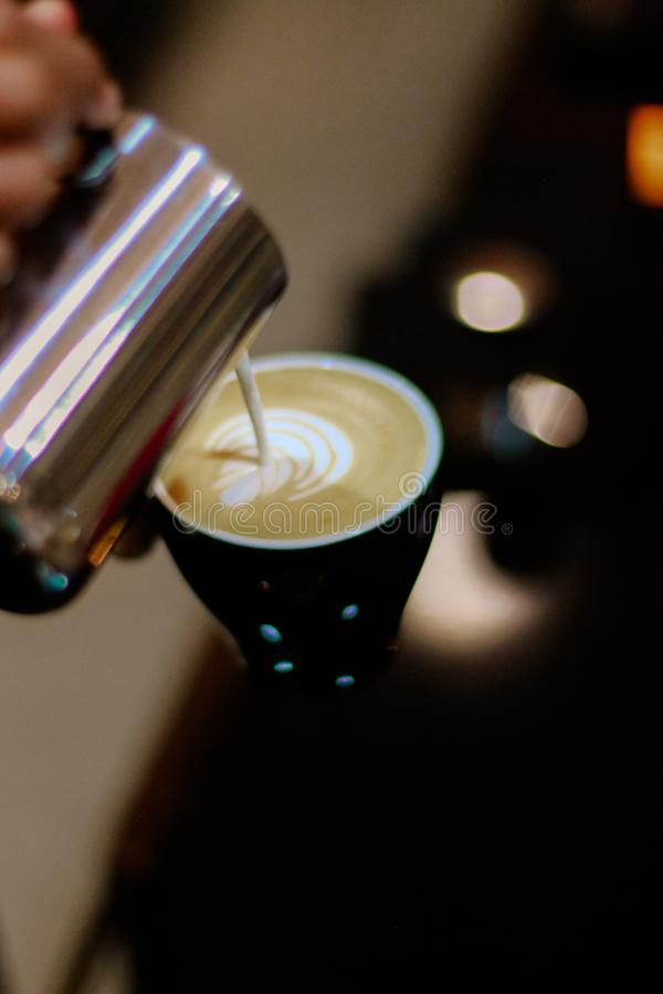 Close-up Photography of Latte Art Making stock photography