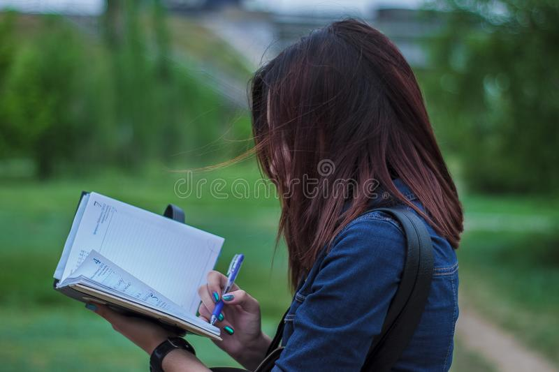 Close-Up Photography of a Person Writing on Notebook stock photo