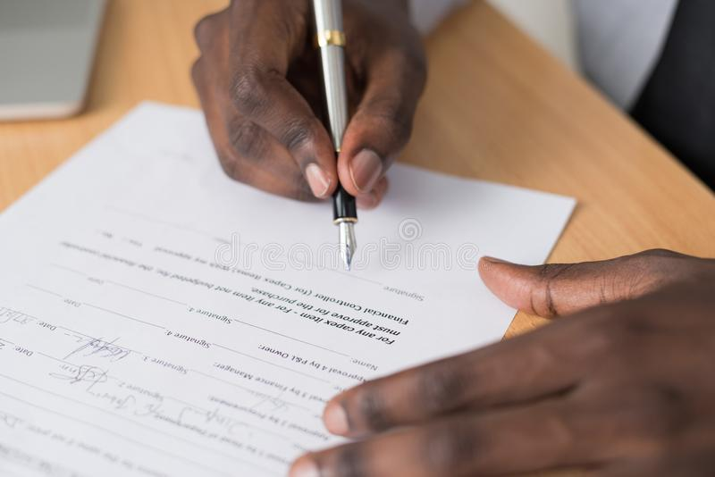 Close-up Photography of Person Writing on White Paper royalty free stock photography