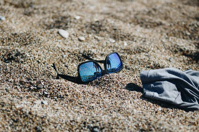Close-Up Photography of Sunglasses on Sand stock image