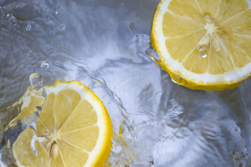 Close Up Photography Of Two Lemon On The Water Sprinkled With Drops Free Public Domain Cc0 Image