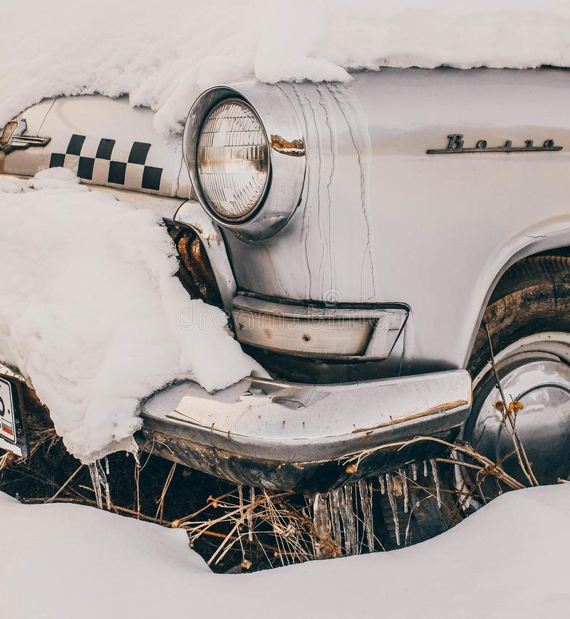 Close-Up Photography of Vintage Car Covered With Snow stock image