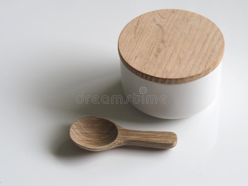 Close-up Photography of White and Brown Wooden Container and Spoon royalty free stock photography
