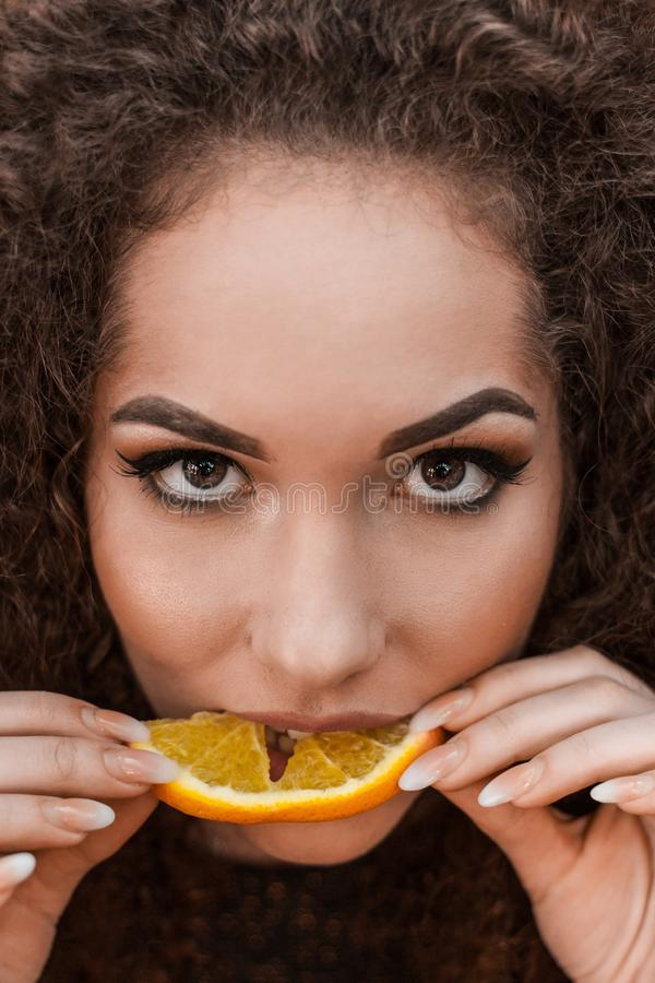 Close-Up Photography of a Woman Eating Orange stock photography