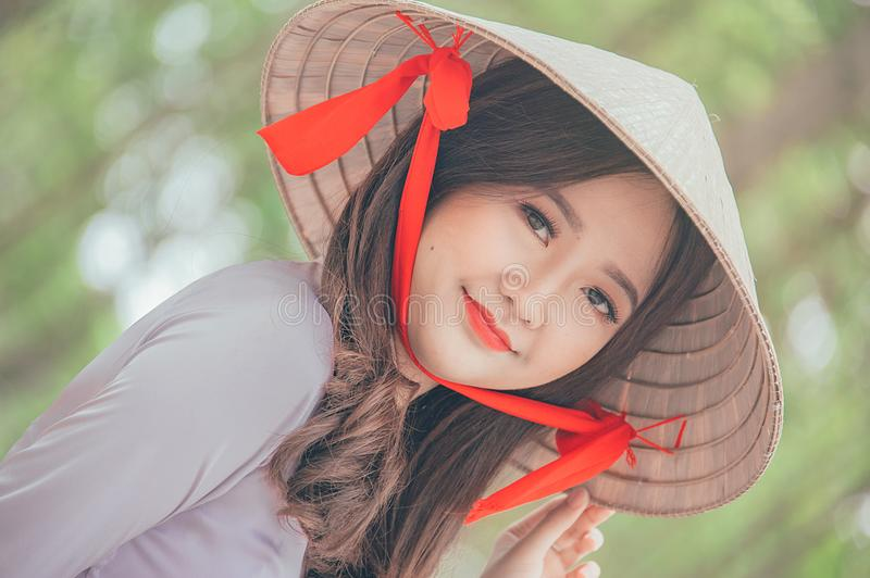 Close-Up Photography of a Woman Wearing Conical Hat stock image