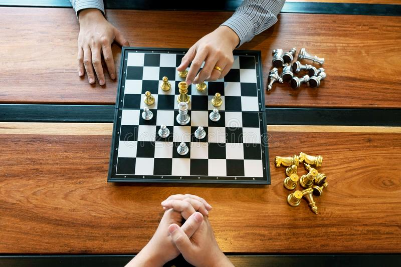 Close-up photos of checkmate hands on a chessboard during a chess game The concept of business victory strategy wins the intellige. Nce game royalty free stock images