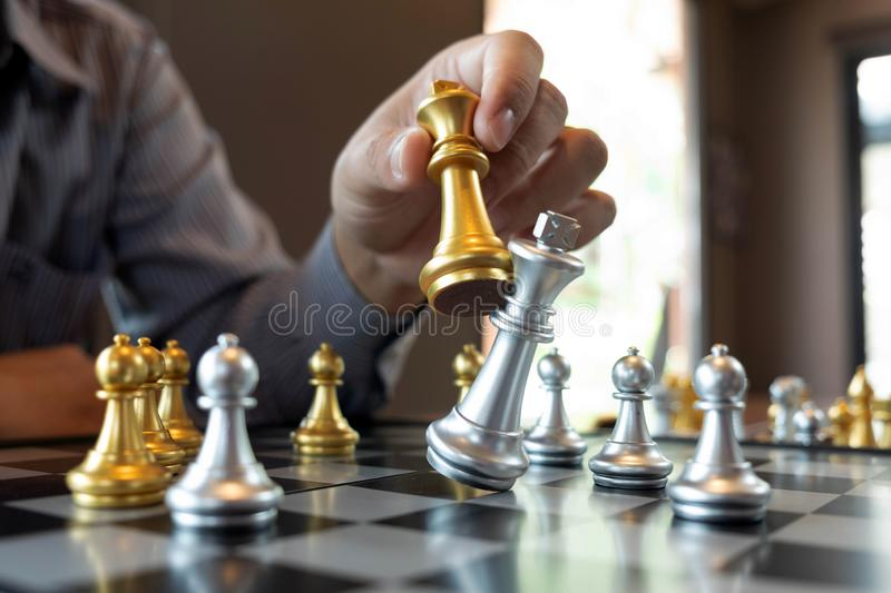 Close-up photos of checkmate hands on a chessboard during a chess game The concept of business victory strategy wins the intellige. Nce game royalty free stock image
