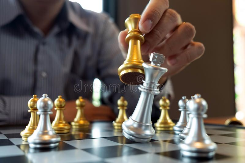 Close-up photos of checkmate hands on a chessboard during a chess game The concept of business victory strategy wins the intellige. Nce game royalty free stock photography
