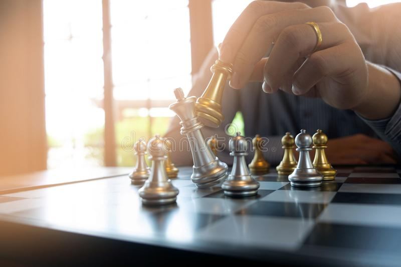Close-up photos of checkmate hands on a chessboard during a chess game The concept of business victory strategy wins the intellige. Nce game stock photos