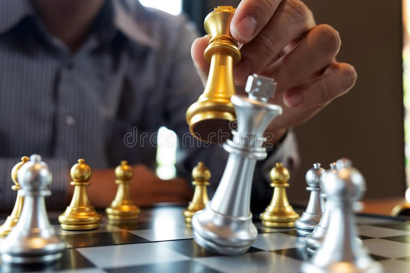 Close-up photos of checkmate hands on a chessboard during a chess game The concept of business victory strategy wins the intellige. Nce game stock photo