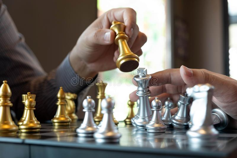 Close-up photos of checkmate hands on a chessboard during a chess game The concept of business victory strategy wins the intellige. Nce game stock image