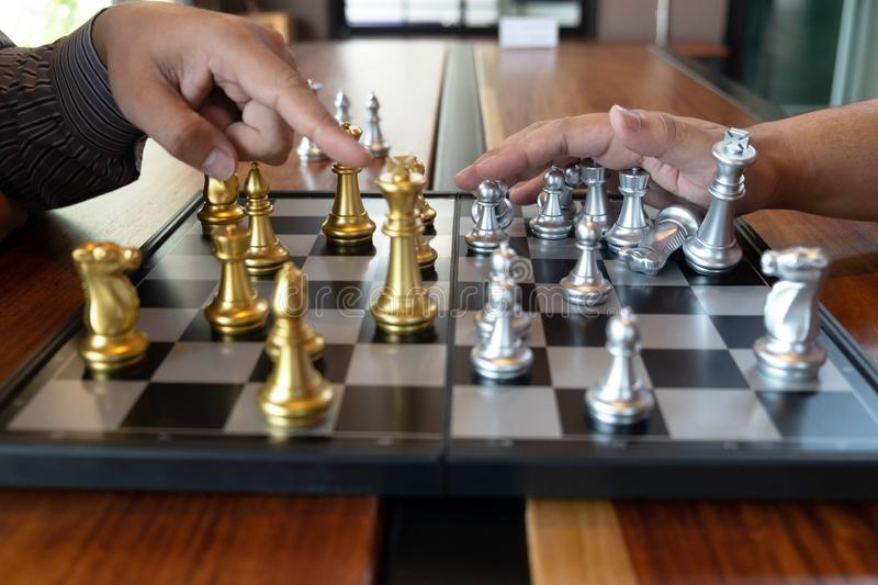 Close-up photos of checkmate hands on a chessboard during a chess game The concept of business victory strategy wins the intellige. Nce game royalty free stock photos
