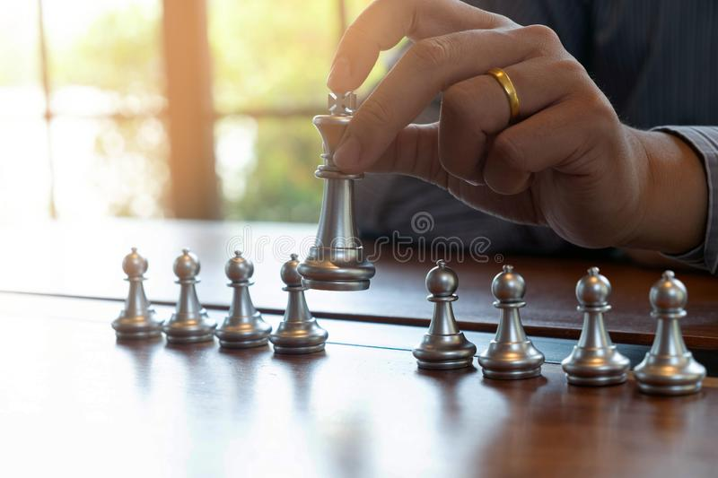 Close-up photos of checkmate hands on a chessboard during a chess game The concept of business victory strategy wins the intellige. Nce game royalty free stock photo
