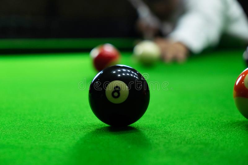 Close-up photos, playing billiard balls, various numbers, stabbing the ball, numbers and green ground.  stock images