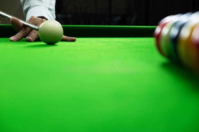Close-up photos, playing billiard balls, various numbers, stabbing the ball, numbers and green ground.  royalty free stock photography