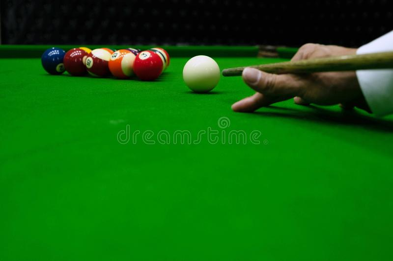 Close-up photos, playing billiard balls, various numbers, stabbing the ball, numbers and green ground.  royalty free stock images