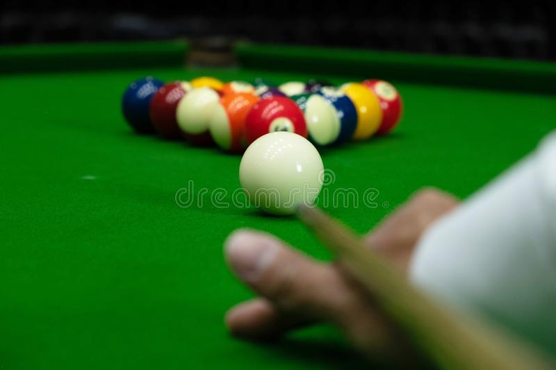 Close-up photos, playing billiard balls, various numbers, stabbing the ball, numbers and green ground.  stock photos