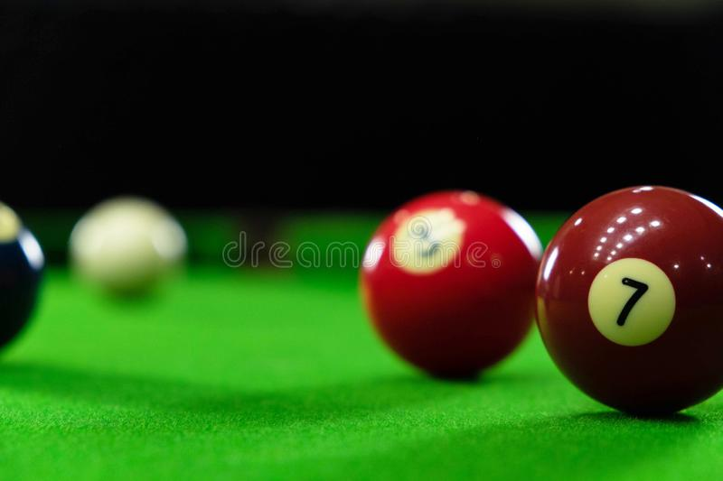 Close-up photos, playing billiard balls, various numbers, stabbing the ball, numbers and green ground.  royalty free stock photos
