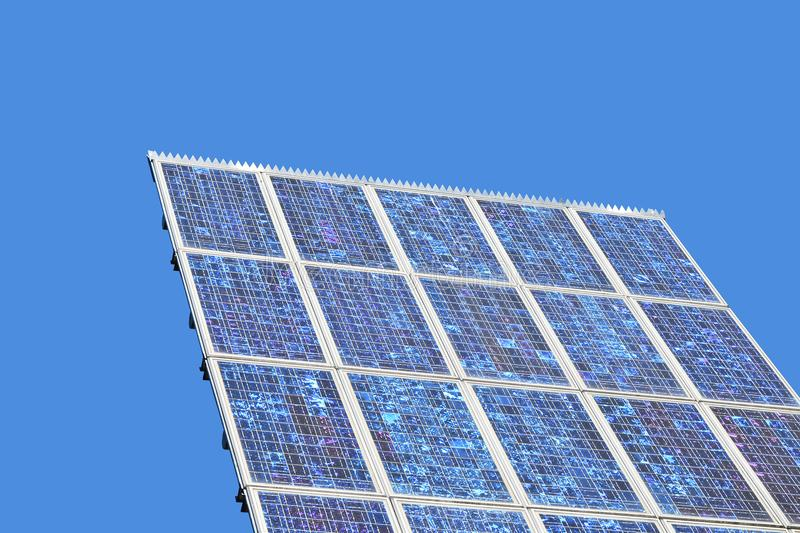 Close up photovoltaic solar panel over blue sky royalty free stock photography