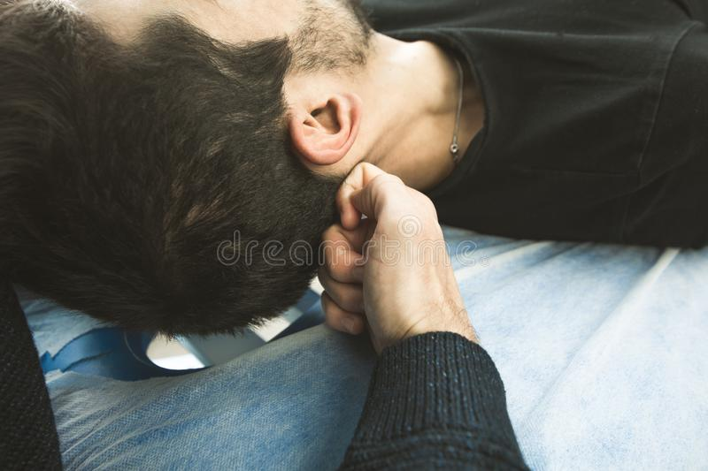 Close-up of a physiotherapist massaging the neck of a young man. Concept of physiotherapy and relaxation royalty free stock photos