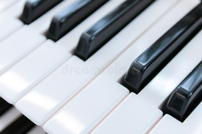 Close up of a piano keyboard.  stock images