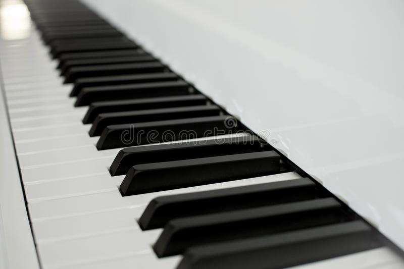 Close up piano keys black and white keys. perspective from piano keyboard. stock photography