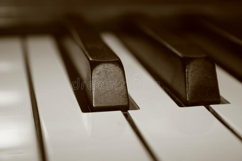 Close up of piano keys in a sepia tone royalty free stock image