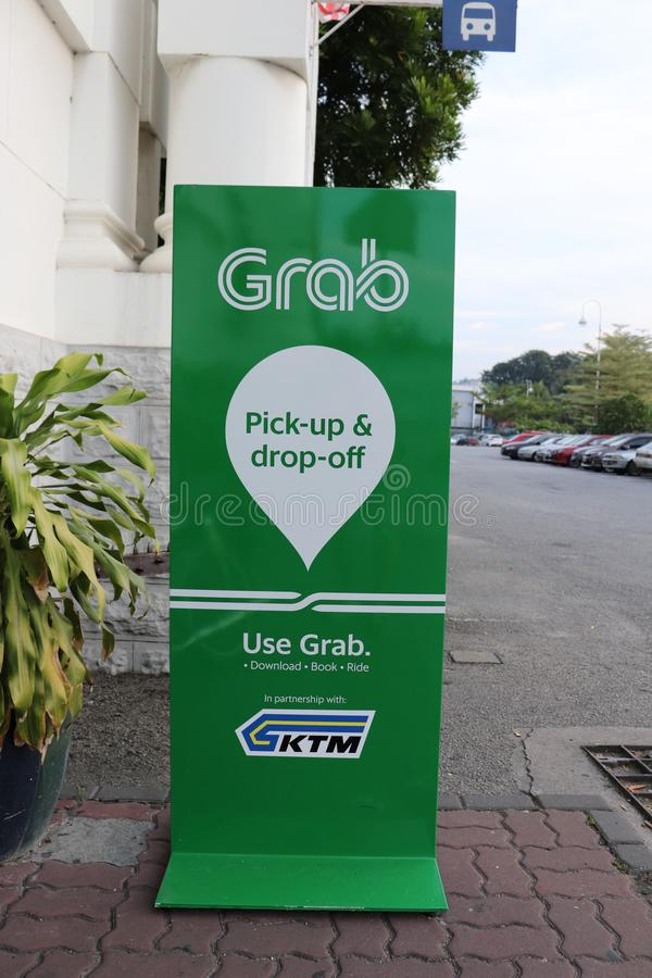 Close-up Of Grab`s Pick-up And Drop-off Sign. Close-up of the pick-up and drop-off signboard of the leading ride-hailing company in Malaysia Grab at the Ipoh stock images