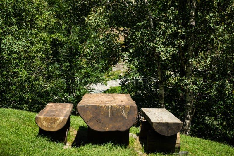 Picnic table in mountain stock photos