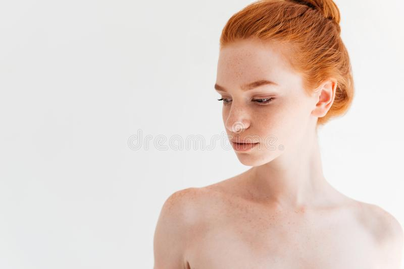 Close up picture of attractive naked ginger woman looking away stock photos