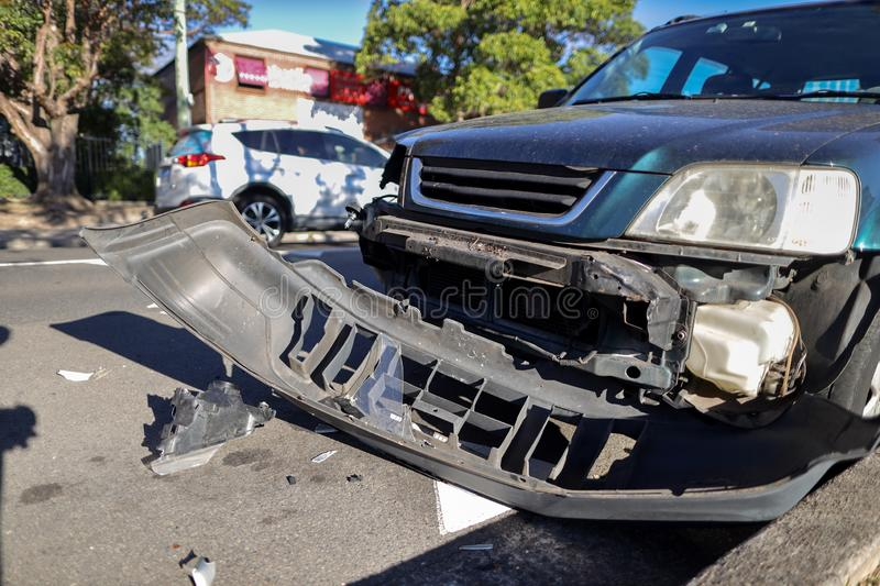 Damage car crushing against road side guard gutter in early morning at Sydney suburb royalty free stock images
