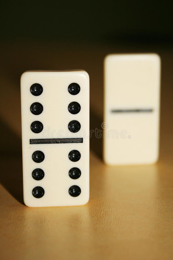 Close up picture of dominos, one from the crowd stock photos