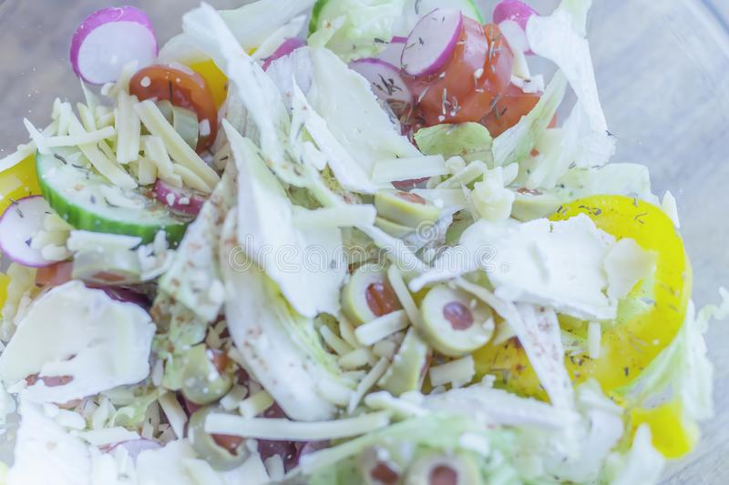 Close up picture of fresh, colourful cheese and vegetable salad. Fresh cheese and mixed vegetable salad close up.Bright and blurred soft image with hint of blue royalty free stock images
