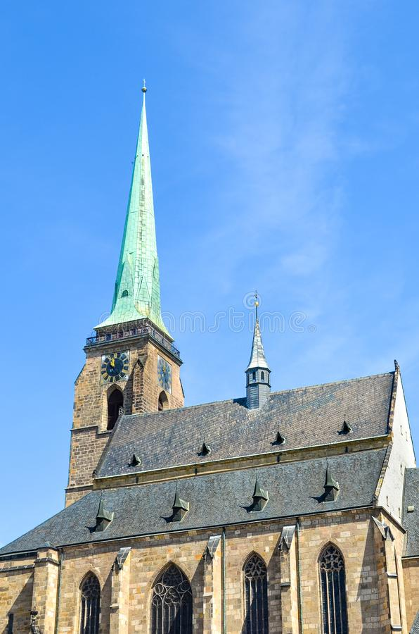 Close up picture of Gothic Saint Bartholomew Cathedral in Pilsen, Czech Republic. Historic cathedral in the old town. The city is royalty free stock images