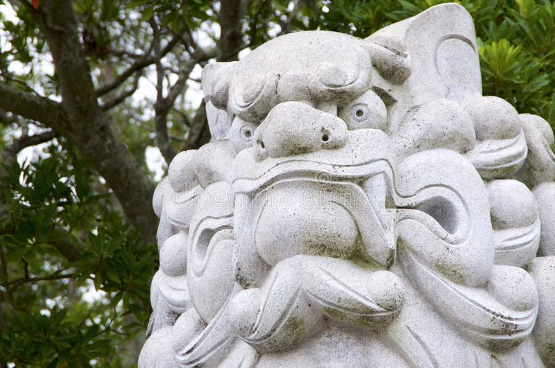Huge Komainu dog-lion like guardian stone statue Izanagi Shrine on Awaji Island in Japan royalty free stock photo